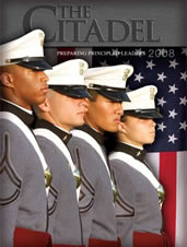 Four cadets in front of American flag